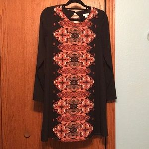 Black long sleeve dress with a red pattern.